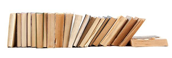 Books stacked in a pile. Old, tattered books